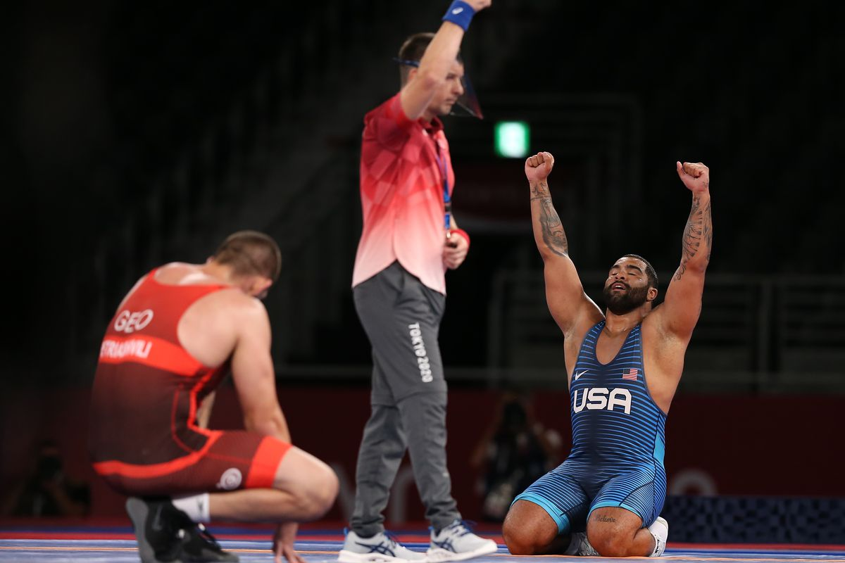 Gable Dan Stevenson (blue) of Team United States celebrates after winning the golden medal during the Men's Freestyle 125kg final in the Tokyo 2020 Olympic Games at Makuhari Messe Hall on August 06, 2021 in Chiba, Japan.