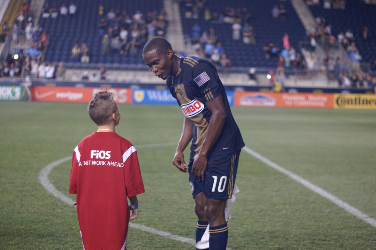 Danny Mwanga chats with Aidan O'Rahilly, winner of the  Verizon FiOS Kid's Challenge at half time of the Chivas USA and Philadelphia Union game. (Photo courtesy of Vault Communications)