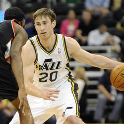Utah Jazz small forward Gordon Hayward (20) looks to get past the defense of Portland Trail Blazers shooting guard Will Barton (5) in the second half of a game at the Energy Solutions Arena on Wednesday, October 16, 2013.