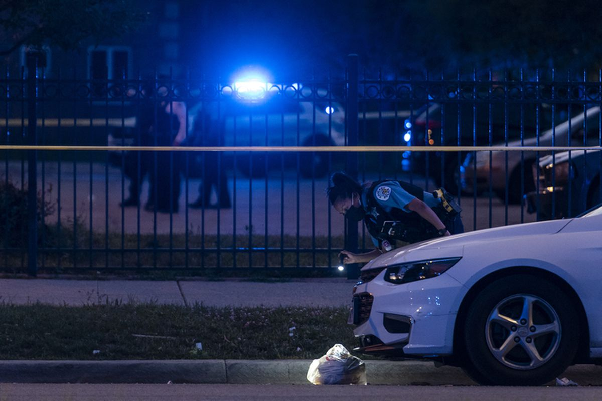 Chicago police investigate a shooting Aug. 6, 2020, in the 2700 block of South State Street.