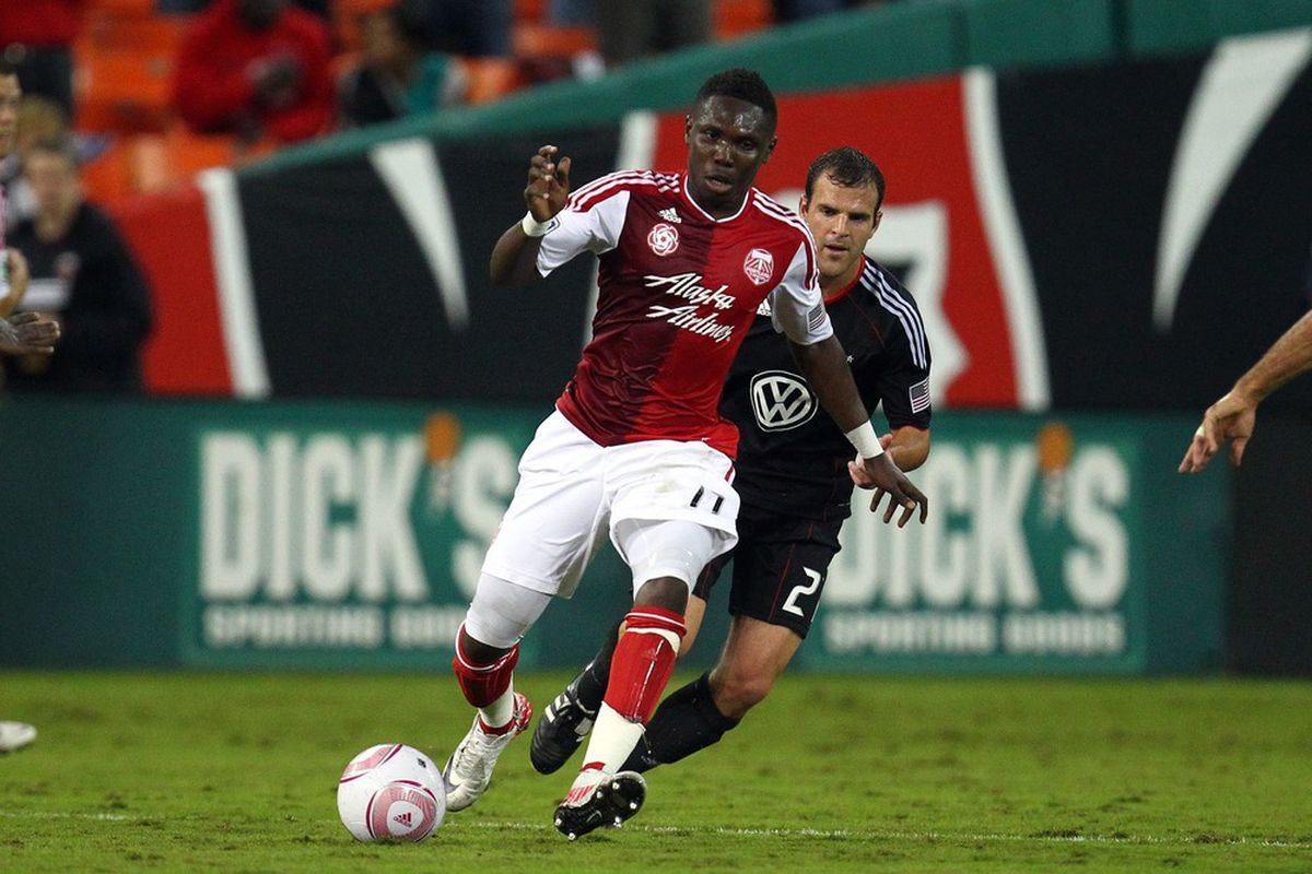 WASHINGTON, DC - OCTOBER 19: Kalif Alhassan #11 of the Portland Timbers controls the ball against Daniel Woolard #21 of D.C. United at RFK Stadium on October 19, 2011 in Washington, DC. (Photo by Ned Dishman/Getty Images)