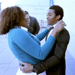 Jean Philippe Desius (right) hugs his wife, Marjorie Desius, both from Haiti, outside the Conference Center in Salt Lake City on April 5, 2015, after President Thomas S. Monson announced during the Sunday morning session of the 185th Annual General Conference of The Church of Jesus Christ of Latter-day Saints that a temple will be built in Haiti.