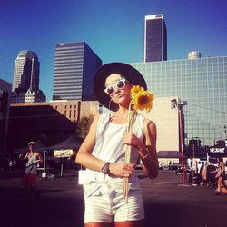 "Sunflowers make for lovely props [Photo via <a href=""http://instagram.com/p/PnYyrsOPOm/"">Neil Favila</a>]"