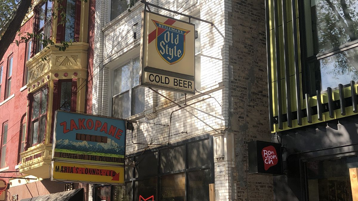 """The exterior of a dive bar with an """"Old Style"""" sign."""