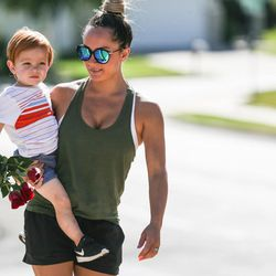 A woman, who declined to provide her name, and her son arrive to leave flowers at a memorial to the victims of Tuesday's fatal shooting on Alta Canyon Drive in Sandy on Wednesday, June 7, 2017.