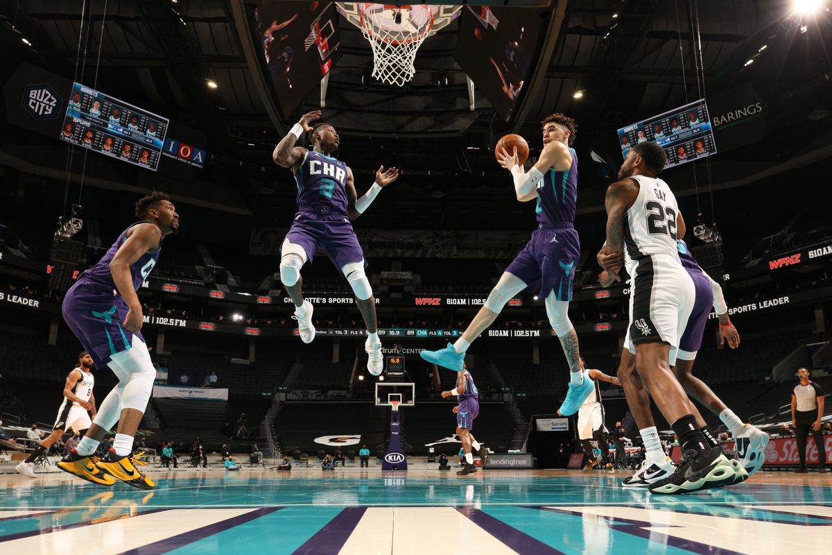 LaMelo Ball of the Charlotte Hornets catches the rebound against the San Antonio Spurs on February 14, 2021 at Spectrum Center in Charlotte, North Carolina.