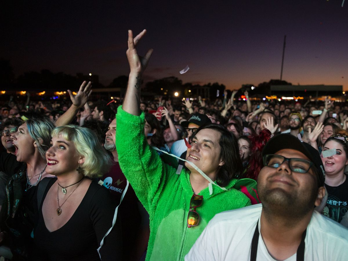 Fans cheer as the Flaming Lips perform on day one of Riot Fest in Douglas Park, Friday night, Sept. 13, 2019.