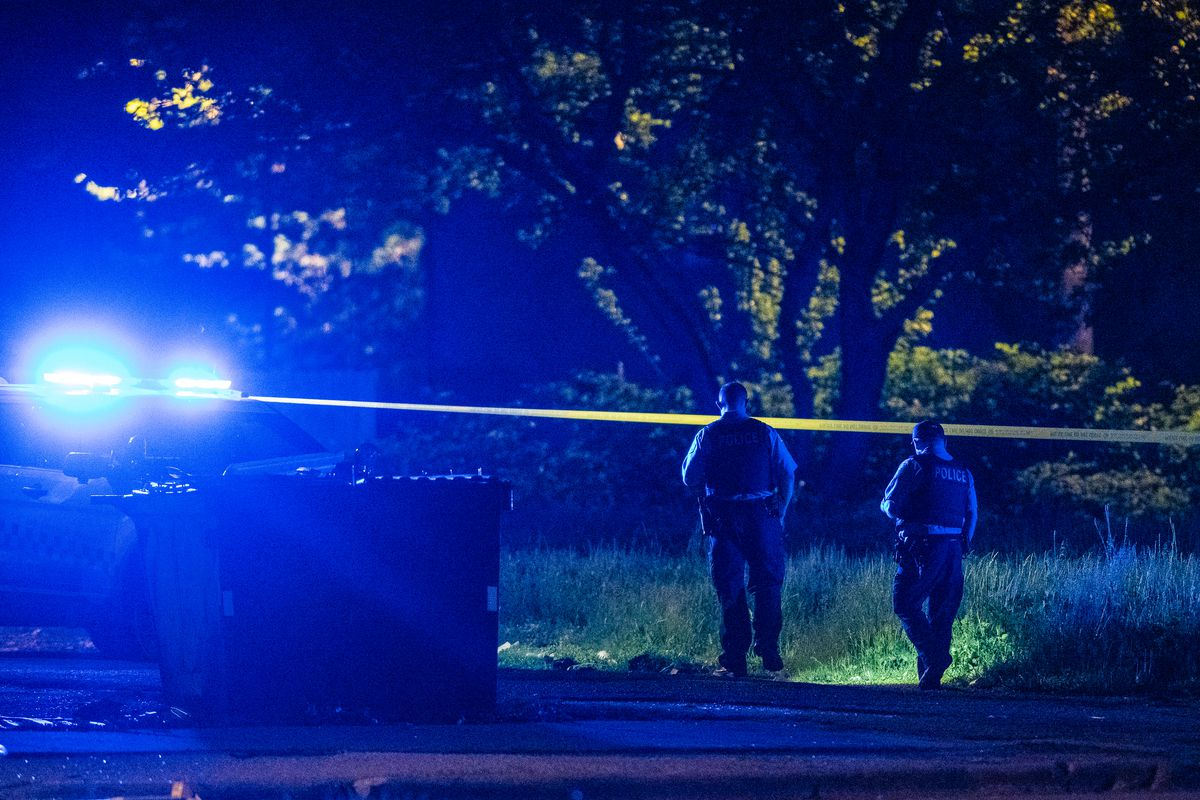 Chicago police officers investigate the scene of a police-involved shooting in Lawndale.