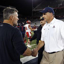 Utah Utes head coach Kyle Whittingham and Arizona Wildcats head coach Rich Rodriguez meet in Tucson, Arizona, on Friday, Sept. 22, 2017. Utah beat Arizona 30-24.