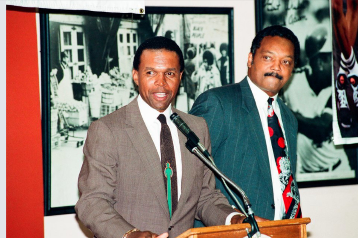 Chicago Bears player Gale Sayers and Rev. Jesse Jackson, Sr., at the Rainbow Commission for Fairness in Athletics at Operation Push on July, 29, 1993