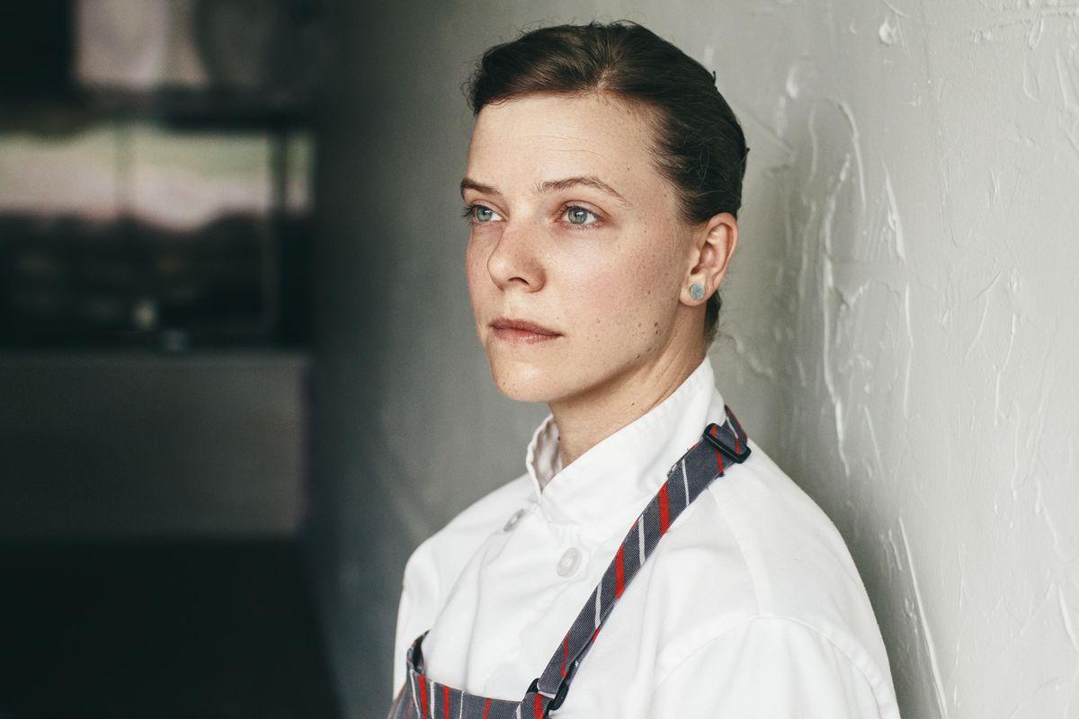 A portrait shot of a white female chef.