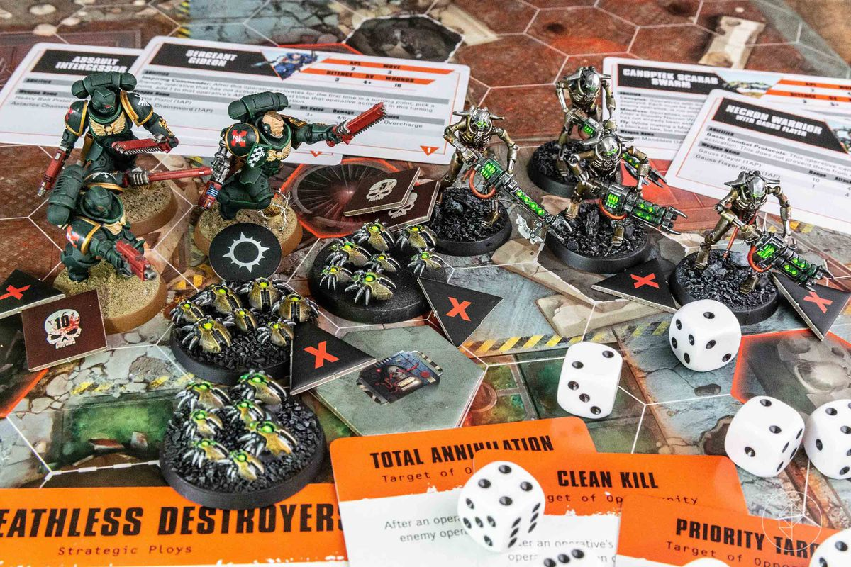 A selection of miniatures painted to a high standard along with cards, dice, and tokens for Fireteam.