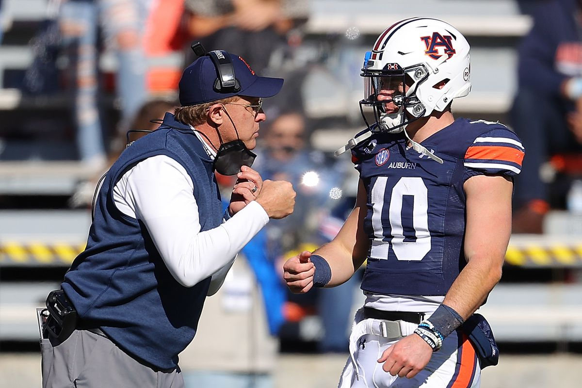Head coach Gus Malzahn of the Auburn Tigers reacts with Bo Nix after he rushed for a touchdown against the Texas A&M Aggies during the second half at Jordan-Hare Stadium on December 05, 2020 in Auburn, Alabama.