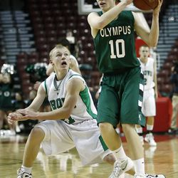 Olympus' #10 Nick Barney, right, keeps the ball away from Provo's #21 Wesley Bosco as Olympus and Provo play in the 4A semifinals Friday, March 2, 2012 at the Maverik Center in West Valley.