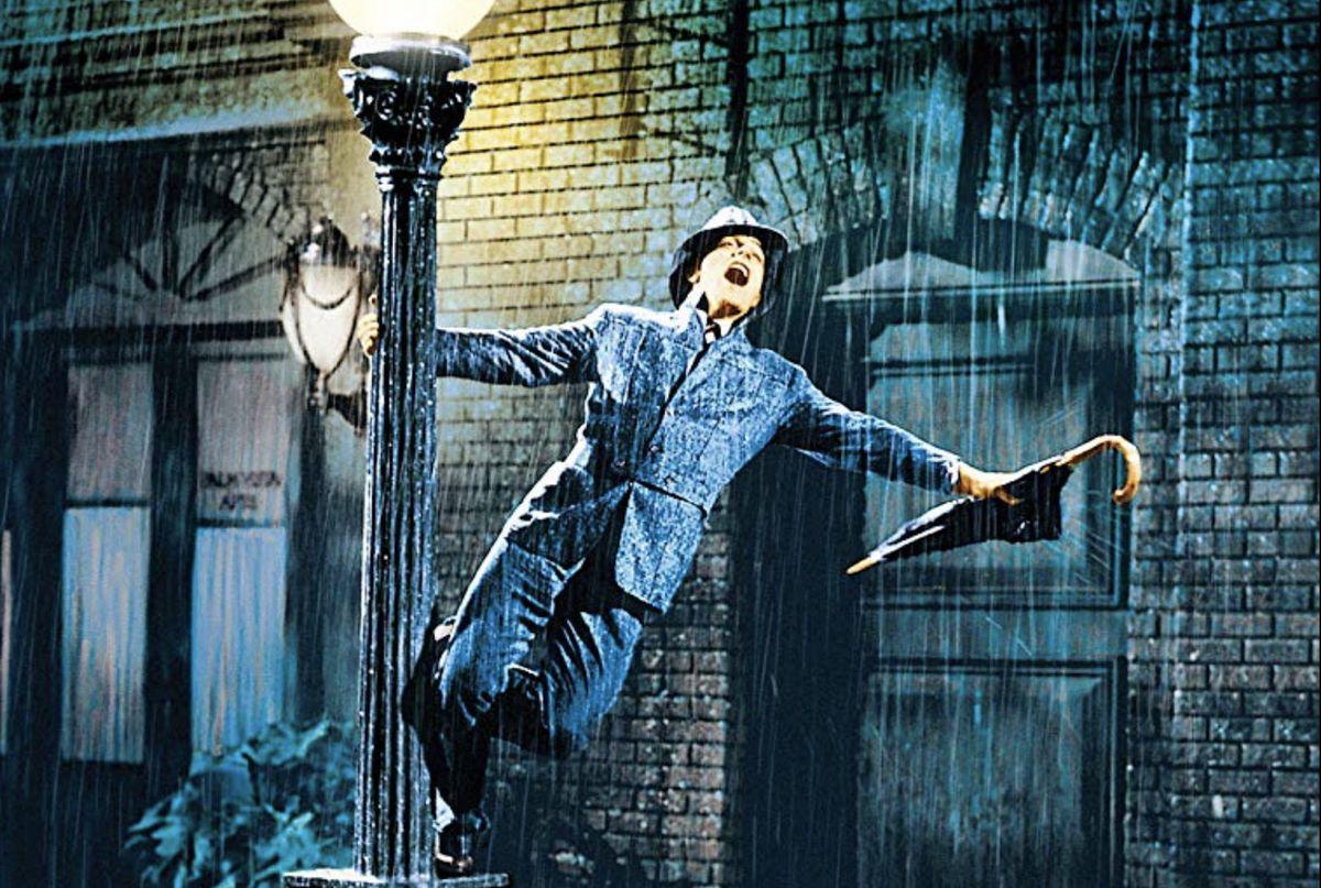 a man hangs off of a lamppost