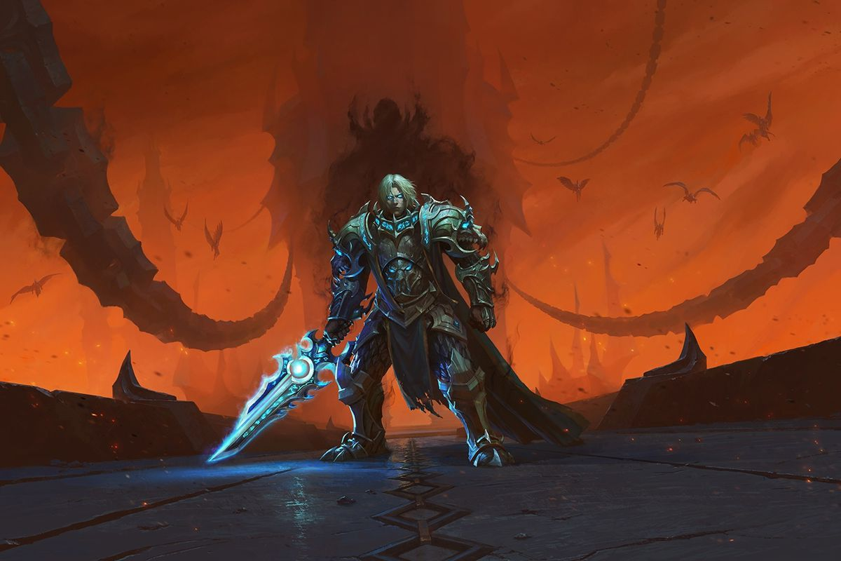World of Warcraft: Shadowlands - key art for the Chains of Domination patch, which shows a mind controlled Anduin Wrynn in grey and blue armor standing against an orange sky. In the distance, the silhouette of the Jailer looms.