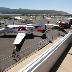 Patrons check out the planes during the Skypark Aviation Festival and Expo at Skypark Airport in Woods Cross on Friday, June 2, 2017. The expo is Utah's largest annual aviation event.