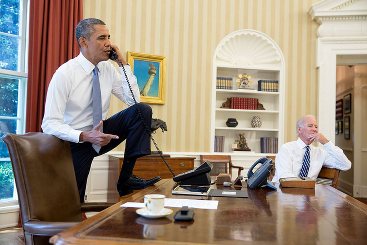 Obama stepping on desk (White House DSouza)