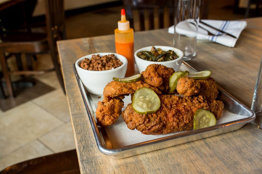Fried chicken on a tray with sides