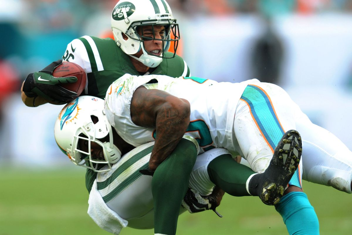 Reshad Jones displaying the type of intimidating power he has when tackling. Jones will need to use that power vs the Broncos to gain a psychological edge in the game.