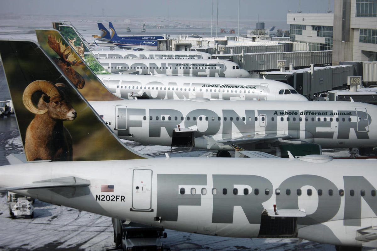 FILE - In this Monday, Feb. 22, 2010, file photo, Frontier Airlines jetliners sit stacked up at gates along the A concourse at Denver International Airport. Carriers are offering more deals to passengers who book flights directly on their websites. Fronti