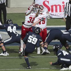 Utah State Aggies place kicker Connor Coles (59) has his extra point kick blocked by Fresno State Bulldogs defensive back Evan Williams (32) in Logan on Saturday, Nov. 14, 2020.