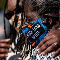 Darlene McDonald, left, and Carol Matthews-Shifflett, both members of Salt Lake City's Commission on Racial Equity in Policing, embrace while speaking at a press conference at the International Peace Gardens in Salt Lake City on Tuesday, April 20, 2021. The group gathered to share their reaction to the guilty verdicts returned in the trial of former police officer Derek Chauvin in Minneapolis.