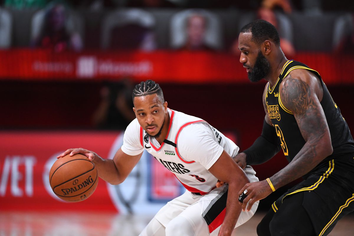 CJ McCollum of the Portland Trail Blazers handles the ball during the game against the Los Angeles Lakers during Round One Game Four of the NBA Playoffs on August 24, 2020 at The AdventHealth Arena at ESPN Wide World Of Sports Complex in Orlando, Florida.