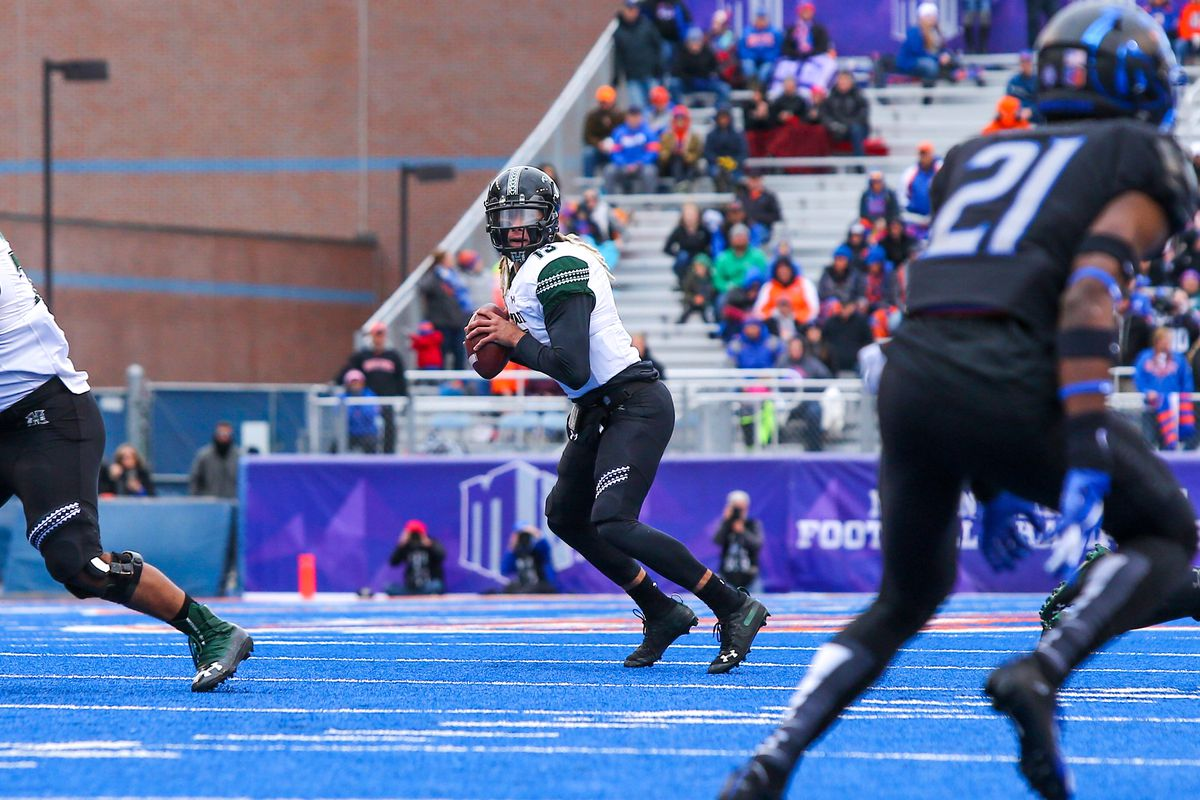 NCAA Football: Mountain West Championship-Hawaii at Boise State. Quarterback Cole McDonald of Hawai'i prepares to throw downfield