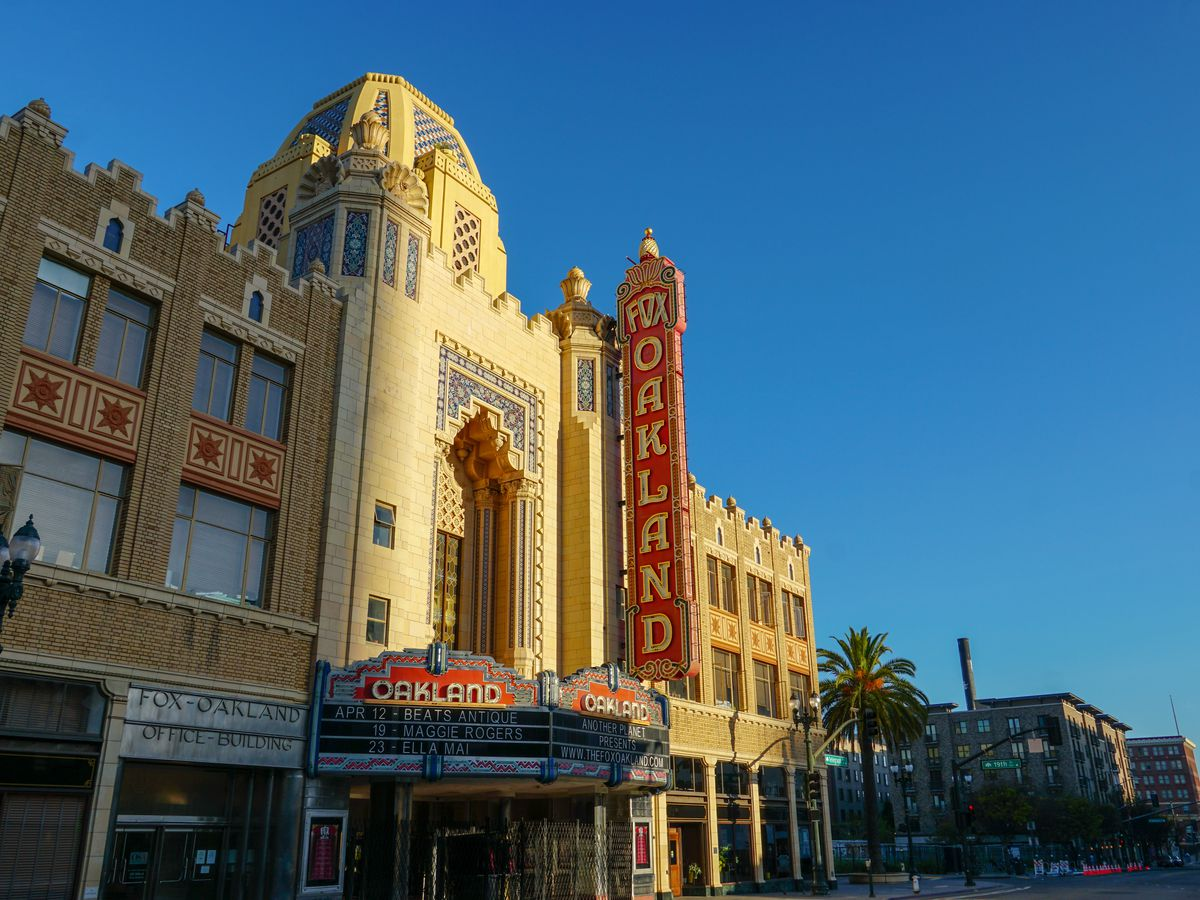 The morning sun rises on the Fox Oakland Theatre, a concert hall and former movie theater in Downtown Oakland
