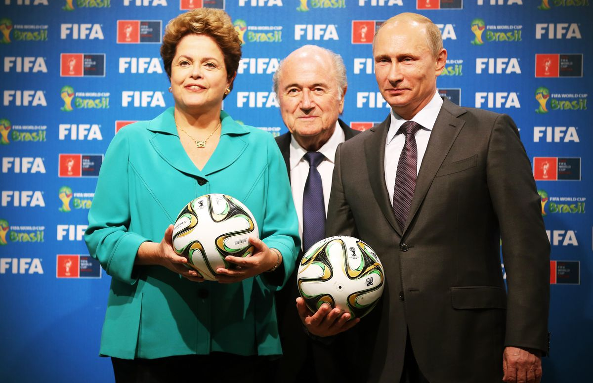 3097a52b0ca6 Brazilian President Dilma Rousseff conducts the official hand over of the  FIFA World Cup from Brazil to Russia with President Vladimir Putin and FIFA  ...