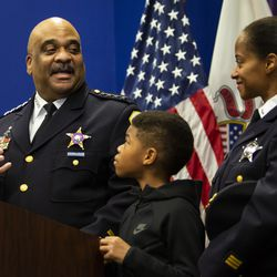 Chicago Police Department Supt. Eddie Johnson looks back at his wife and 10-year-old son as he announces his retirement during a press conference at CPD headquarters, Thursday morning, Nov. 7, 2019.