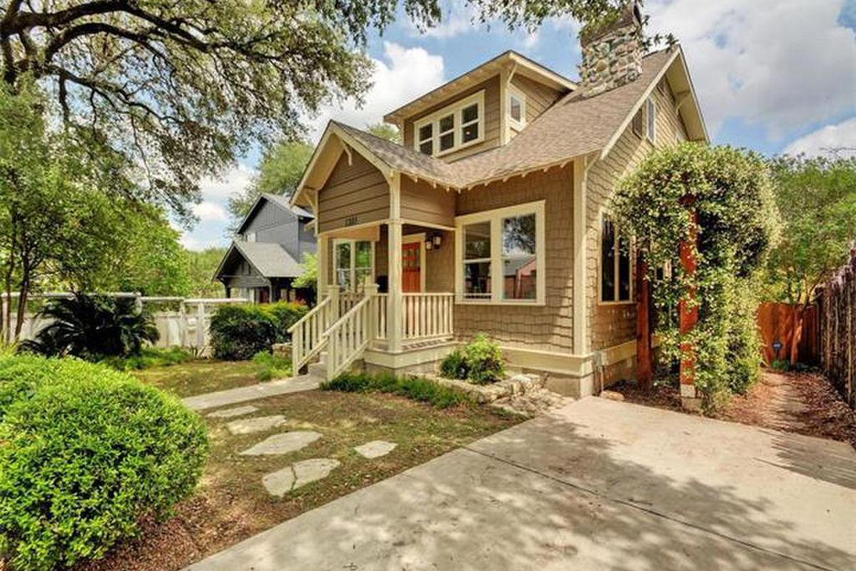 Wood frame home, bungalow style, tan with white trim