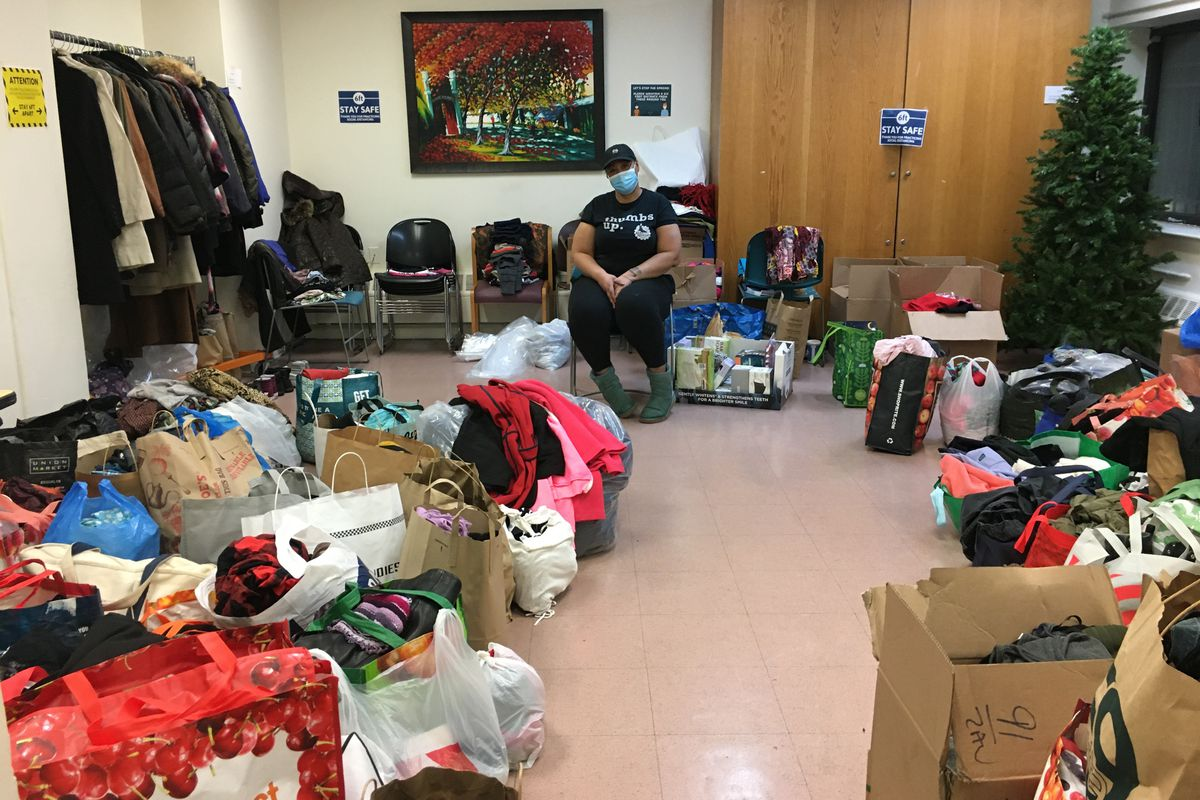 Women's Prison Association coordinator Tracey Thomas is surrounded by donations following the fire at their East Village shelter, Dec. 6, 2020.