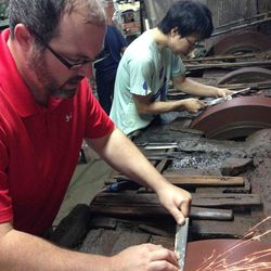 """<b>Derek Swanson, co-owner of <a href=""""http://www.dcmobilesharpening.com"""">DC Sharp</a>:</b> """"Here is a photo of me grinding a sushi knife at Kenichi Shiraki's shop in Sakai, Japan. Shiraki is currently considered the greatest knife maker in Japan. We also"""