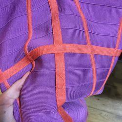 Loose threads on the Hervé Leger dress