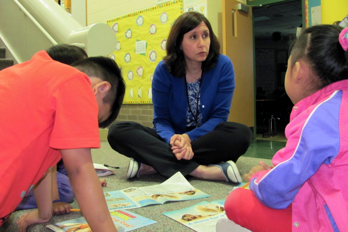 Carol Hofer, a teacher at Fox Hill Elementary School, works with English learners in a small group lesson. Teachers with special skills such as an English learner certification are harder for districts to recruit.