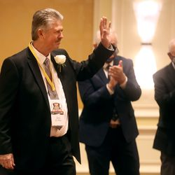 Professional golfer Jay Don Blake waves to the crowd as he is honored at the Utah Sports Hall of Fame banquet at the Little America Hotel in Salt Lake City on Monday, Sept. 20, 2021.