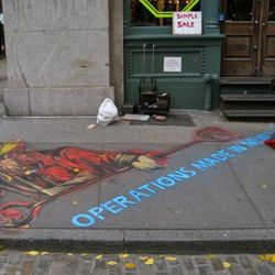 Hani Shihada lays down some sidewalk art for the former tenant at 60 Mercer in October 2009.