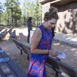 Meleeza Hall lays out the worship books provided by the ACMNP before the 9:30 a.m. nondenominational Christian church service in Bryce Canyon National Park, Sunday, June 18, 2017.