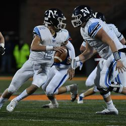 Nazareth's J.J. McCarthy (2) runs away from St. Charles North's defense. Worsom Robinson/For the Sun-Times.