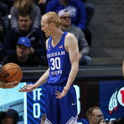 Brigham Young Cougars guard TJ Haws (30) argues with a referee during the game against the Utah Utes at the Marriott Center in Provo on Saturday, Dec. 16, 2017.