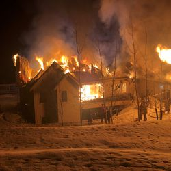 A house in Hobble Creek Canyon in Springville is engulfed in flame during an early morning fire on Friday, Feb. 21, 2020.