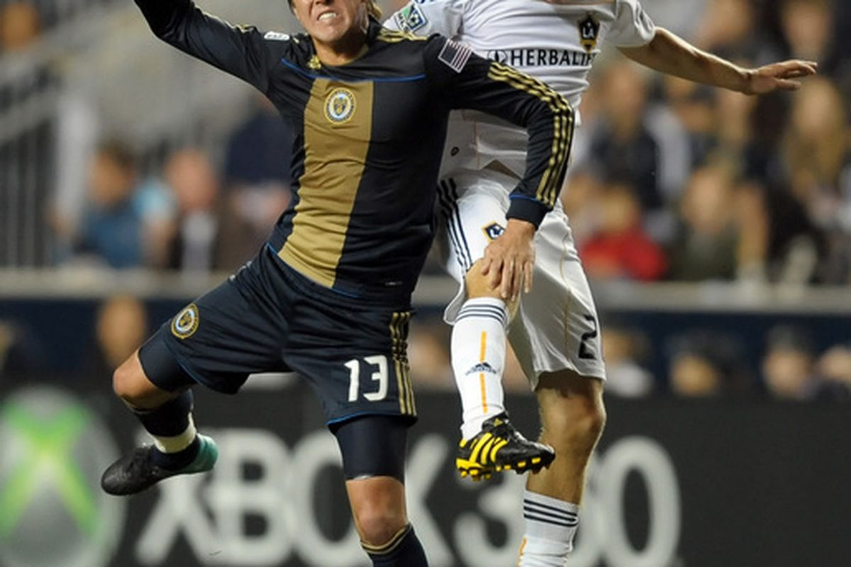 CHESTER PA- OCTOBER 07: Kyle Nakazawa #13 of the Philadelphia Union and Michael Stephens #26 of the Los Angeles Galaxy go up to head the ball at PPL Park on October 7 2010  in Chester Pennsylvania. (Photo by Drew Hallowell/Getty Images)