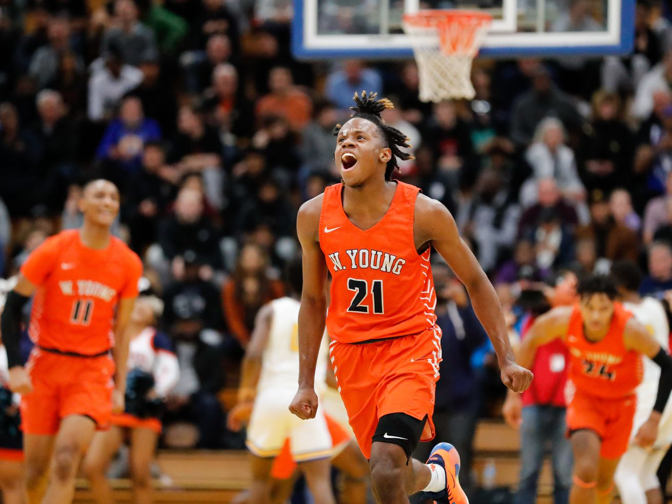 Young's DJ Steward (21) reacts during the game against Simeon.