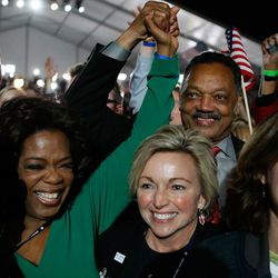 Oprah Winfrey and Rev. Jesse Jackson react after projections showed that Obama will be elected president. | Joe Raedle/Getty Images