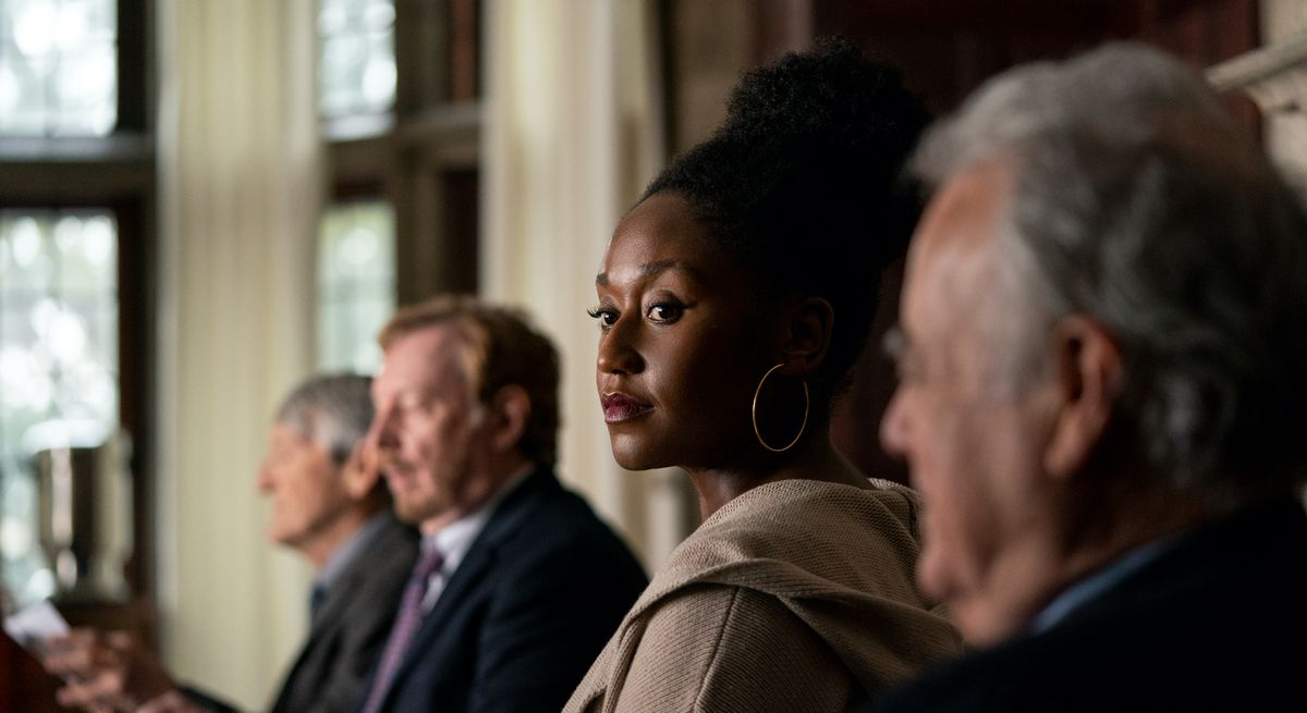 Nana Mensah as a young, Black professor in a line of much older white men in Netflix's The Chair