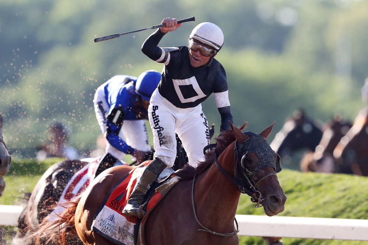 Joel Rosario celebrates after winning the Belmont Stakes aboard Sir Winston on Saturday in Elmont, New York.