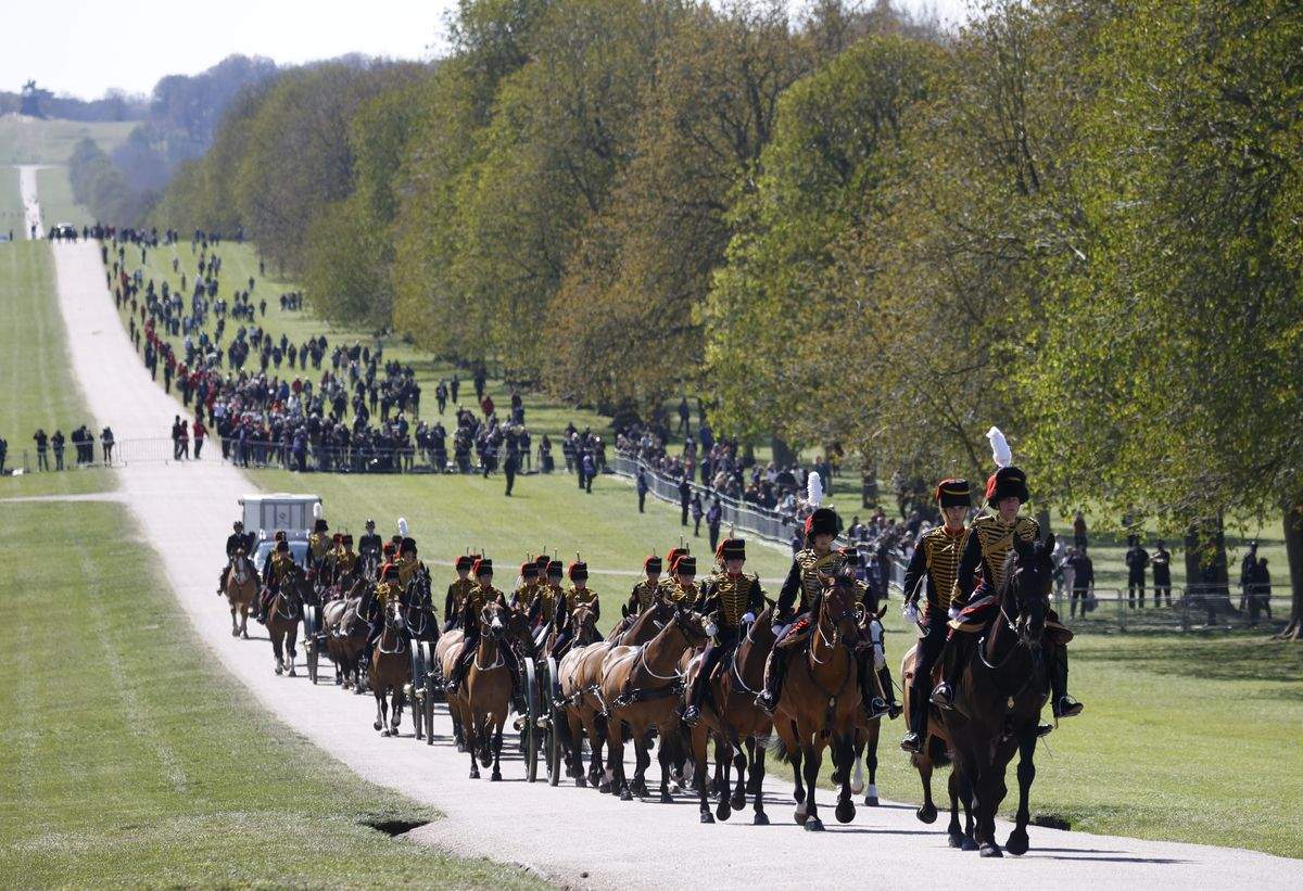 Officers of The King's Troop Royal Horse Artillery arrive for the Gun Salute for the funeral of Britain's Prince Philip at Windsor Castle in Windsor, England Saturday, April 17, 2021.