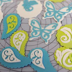 Patterns like this can be made using the Cricut, a product made by Provo Craft.